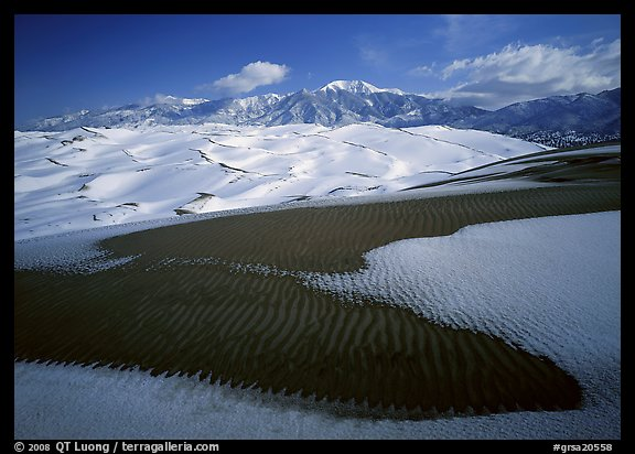 Patch of sand, snow-covered dunes, Sangre de Christo mountains. Great Sand Dunes National Park and Preserve (color)