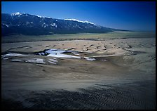 Sand dunes with patches of snow seen from above. Great Sand Dunes National Park, Colorado, USA.