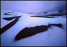 Patch of sand in snow-covered dunes at dawn. Great Sand Dunes National Park ( color)