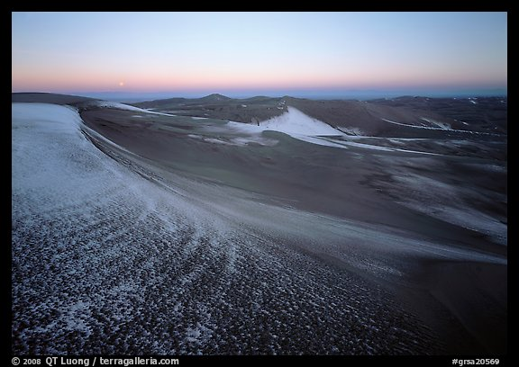 Sparse snow on the dunes at dawn. Great Sand Dunes National Park, Colorado, USA.