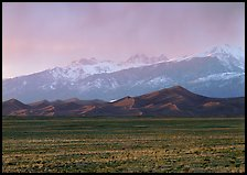 Flats, sand dunes, and snowy Sangre de Christo mountains. Great Sand Dunes National Park, Colorado, USA. (color)