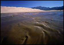 Medano creek with shifting sands, dunes and Sangre de Christo mountains. Great Sand Dunes National Park and Preserve, Colorado, USA.