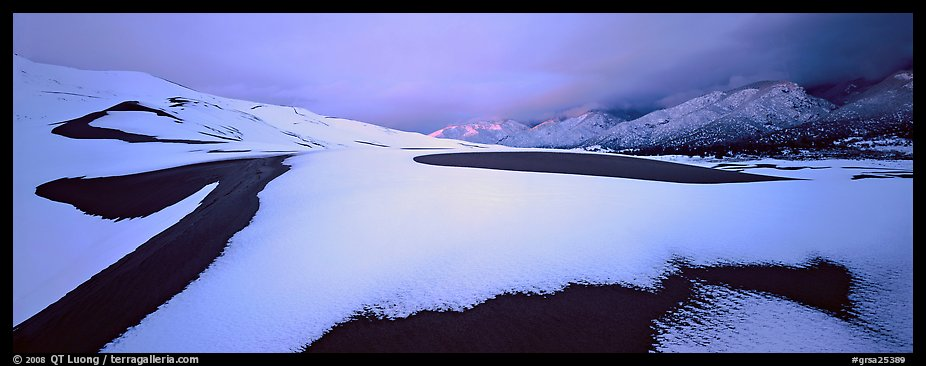 Snow-covered dune landscape and mountains at dawn. Great Sand Dunes National Park and Preserve (color)