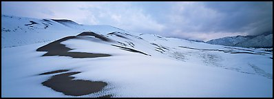 Dune field covered by snow. Great Sand Dunes National Park and Preserve (Panoramic color)