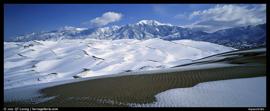 Landscape of snowy dunes and mountains. Great Sand Dunes National Park and Preserve (color)