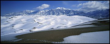 Landscape of snowy dunes and mountains. Great Sand Dunes National Park (Panoramic color)