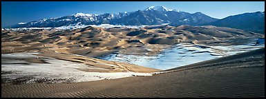 Landscape of sand dunes and mountains in winter. Great Sand Dunes National Park and Preserve (Panoramic color)