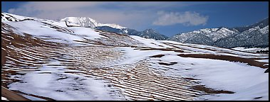 Melting snow on sand dunes. Great Sand Dunes National Park and Preserve (Panoramic color)