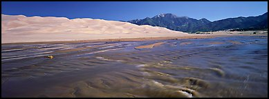 Wide shallow creek at the base of dune field. Great Sand Dunes National Park and Preserve (Panoramic color)