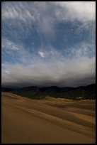 Dunes, moonlit clouds, and stars. Great Sand Dunes National Park, Colorado, USA. (color)