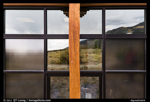 Grasslands and mountains, visitor center window reflexion. Great Sand Dunes National Park and Preserve (color)