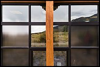 Grasslands and mountains, visitor center window reflexion. Great Sand Dunes National Park, Colorado, USA. (color)