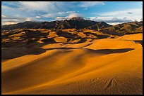 Dune field and Sangre de Cristo mountains at sunset. Great Sand Dunes National Park, Colorado, USA. (color)