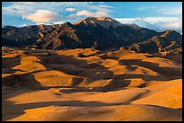 Last light over dune field and Mount Herard. Great Sand Dunes National Park, Colorado, USA. (color)