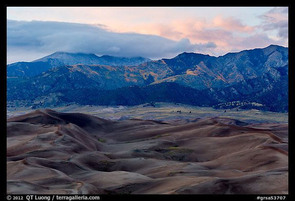 Dunes and mountains with fall colors at dusk. Great Sand Dunes National Park and Preserve (color)