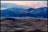 Dunes and mountains with fall colors at dusk. Great Sand Dunes National Park, Colorado, USA. (color)