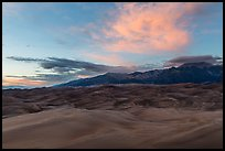 Dune field and Sangre de Cristo mountains with cloud lighted by sunset. Great Sand Dunes National Park, Colorado, USA. (color)