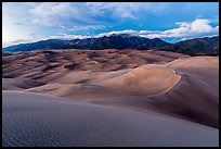 Dunes and Sangre de Cristo mountains at dusk. Great Sand Dunes National Park, Colorado, USA. (color)