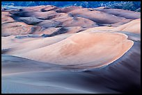 Large dune field in lilac afterglow. Great Sand Dunes National Park, Colorado, USA. (color)