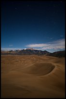 Dunes and Sangre de Cristo Mountains at night. Great Sand Dunes National Park and Preserve, Colorado, USA.