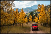 Jeep on Medano primitive road near Medano Pass in autumn. Great Sand Dunes National Park and Preserve ( color)