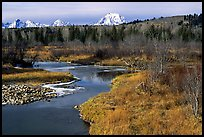 Stream, with Mt Moran emerging from ridige, late fall. Grand Teton National Park, Wyoming, USA. (color)