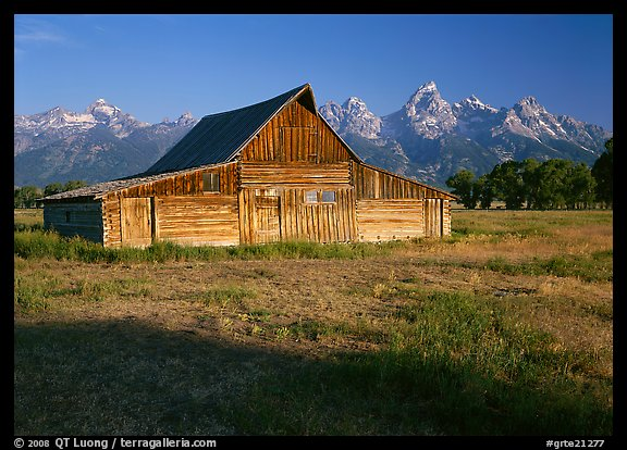 Historic Barn and Teton range, morning. Grand Teton National Park, Wyoming, USA.