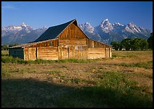 Historic Barn and Teton range, morning. Grand Teton National Park, Wyoming, USA. (color)