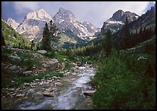 Valley, Cascade creek and Teton range with storm light. Grand Teton National Park, Wyoming, USA.