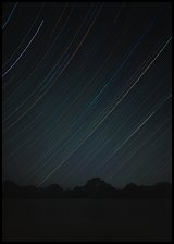 Star trails and Teton range. Grand Teton National Park, Wyoming, USA. (color)