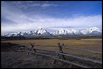 Fence, meadow, and Teton Range. Grand Teton National Park, Wyoming, USA.