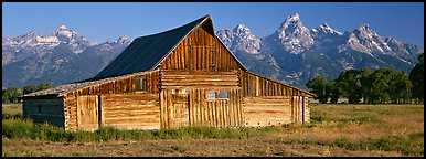 Wooden barn and mountain range. Grand Teton National Park (Panoramic color)