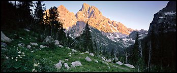 Rugged peaks lit by last light. Grand Teton National Park (Panoramic color)