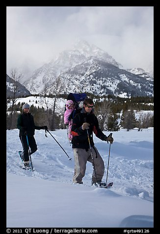 Couple snowshowing with baby. Grand Teton National Park, Wyoming, USA.