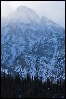 Towering mountain in winter. Grand Teton National Park, Wyoming, USA.