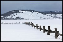 Fence, snowdrift and Ulh Hill. Grand Teton National Park ( color)