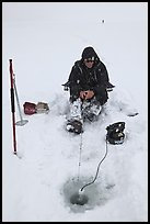 Man ice fishing with radar on Jackson Lake. Grand Teton National Park, Wyoming, USA. (color)