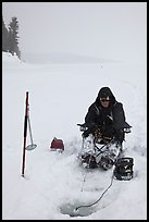 Ice fisherman with lounge chair and radar,Jackson Lake. Grand Teton National Park ( color)