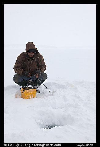 Ice fishing during a snow storm, Jackson Lake. Grand Teton National Park (color)