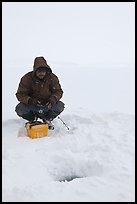 Ice fishing during a snow storm, Jackson Lake. Grand Teton National Park ( color)
