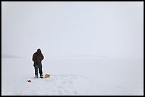 Ice fishing on Jackson Lake. Grand Teton National Park, Wyoming, USA. (color)