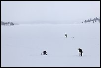 Jackson Lake in winter with ice fishermen. Grand Teton National Park, Wyoming, USA.