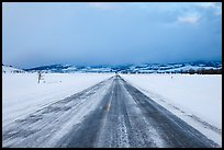 Road in winter at dusk, Gross Ventre valley. Grand Teton National Park, Wyoming, USA.