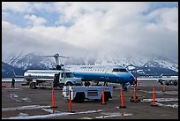Regional jet and fuel truck, Jackson Hole Airport. Grand Teton National Park, Wyoming, USA. (color)