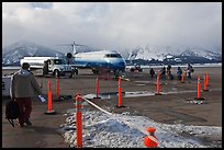 Passengers walking towards plane on Jackson Hole Airport. Grand Teton National Park, Wyoming, USA. (color)