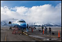 Passengers boarding aircraft, Jackson Hole Airport, winter. Grand Teton National Park, Wyoming, USA. (color)