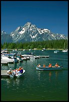 Boaters at Colter Bay marina with Mt Moran in the background, morning. Grand Teton National Park, Wyoming, USA. (color)