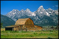 Historic Moulton Barn and Tetons mountain range, morning. Grand Teton National Park, Wyoming, USA.