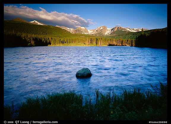 Rippled water in Sprague Lake, and snowy mountain range. Rocky Mountain National Park (color)