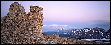Rock towers on high pass and mountains at dusk. Rocky Mountain National Park, Colorado, USA.